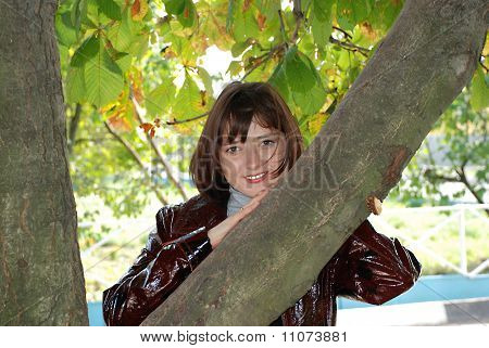 The Girl Near A Tree