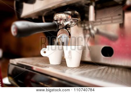 Espresso Machine Pouring Coffee In Cups