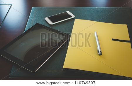 Smartphone, tablet, document files and a pen on my office desk
