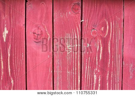 Red painted threadbare wooden plank