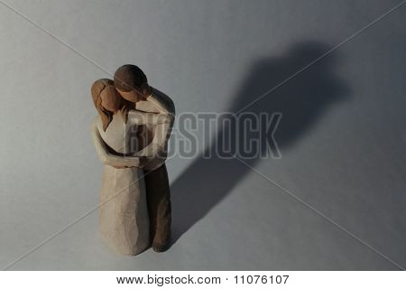 Couple Statue With Shadow Backdrop