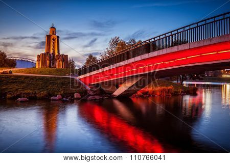 MINSK, BELARUS - SEPTEMBER 19, 2014:  Island of Tears with Afganistan war memorial in evening twilight.  Minsk, Belarus