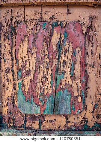 detail of peeling paint from a wooden door