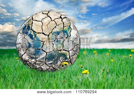 Earth Among The Green Grass Against The Blue Sky. Elements Of This Image Furnished By Nasa
