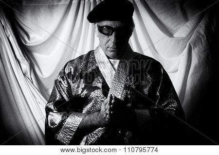 Holy Man In Kimono Praying