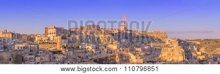 Panoramic View Of Typical Stones And Church Of Matera And The Madonna De Idris Under Begin Sunset Sk