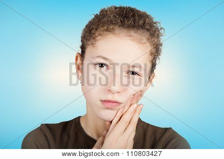 ortrait of a Young girl with toothache