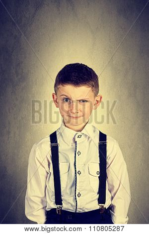 Funny emotionof little boy young man with a raised eyebrow wearing costume