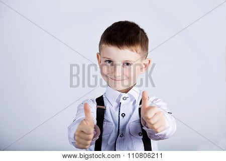 Little boy with thumb up gesture isolated overwhite