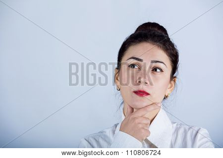Serious business young woman thinking