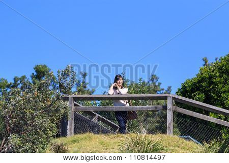 Young Woman Traveler Smiling Happy. Tourist With Travel In Byron Bay , Nsw, Australia