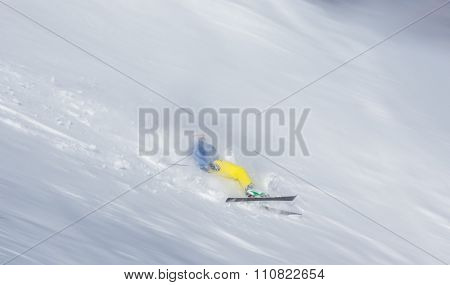 Skier falling on the slope , action photo of accident