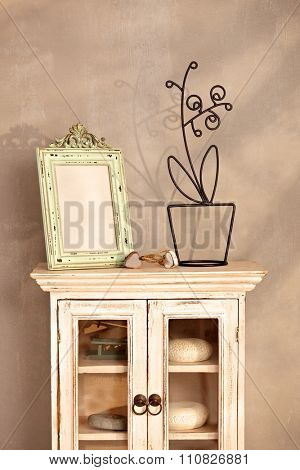 Vintage interior with show-case and frame.