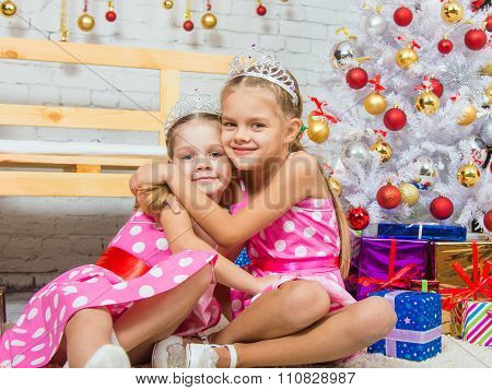 Two Girls Embrace At The Christmas Trees