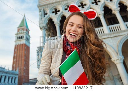Woman Tourist Showing Italian Flag On Piazza San Marco In Venice