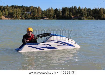 Young man near his jet ski.
