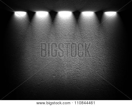 black wall with spotlights