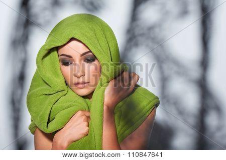 Woman with smokey makeup and green turban