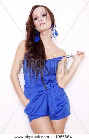 Portrait of a beautiful young adult attractive sensuality and sexy pretty brunette woman posing in blue dress isolated on white background