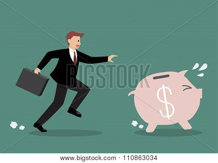 Businessman Try To Catch Piggy Bank