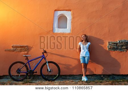 teenage girl and bike in city