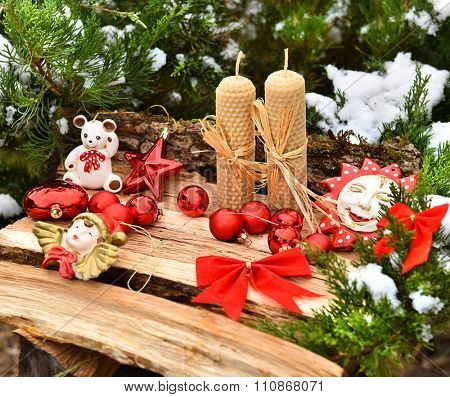 Christmas tree closeup angel red balls snow decoration candels wooden texture
