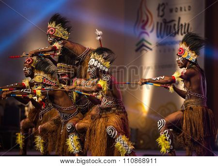 JAKARTA, INDONESIA: NOVEMBER 13, 2015: Dancers perform a traditional Papua warrior dance at the opening ceremony of the 13th World Wushu Championship 2015 in Jakarta Convention Centre.
