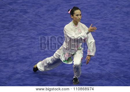 JAKARTA, INDONESIA: NOVEMBER 14, 2015: Chen Suijin from Hong Kong performs the movements in the women's Taijiquan event at the 13th World Wushu Championship 2015 held at Istora Senayan, Jakarta.