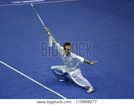 JAKARTA, INDONESIA: NOVEMBER 14, 2015: Peter Hlawaty from Slovakia performs the movements in the men's Jianshu event at the 13th World Wushu Championship 2015 held at Istora Senayan, Jakarta.