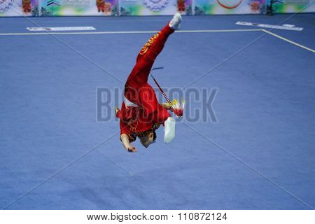 JAKARTA, INDONESIA: NOVEMBER 14, 2015: Leslie Kwan from Canada performs the movements in the men's Jianshu (sword) event at the 13th World Wushu Championship 2015 in Istora Senayan, Jakarta.