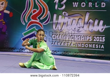 JAKARTA, INDONESIA - NOVEMBER 14, 2015: Sandi Oo from Myanmar performs the movements in the women's Changquan event in the 13th World Wushu Championship 2015 held in Istora Senayan, Jakarta.
