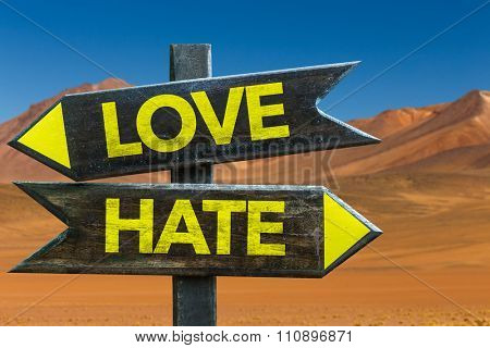 Love - Hate signpost in a desert background