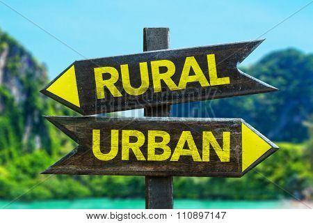 Rural - Urban signpost in a beach background