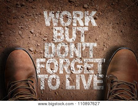 Top View of Boot on the trail with the text: Work But Don't Forget to Live