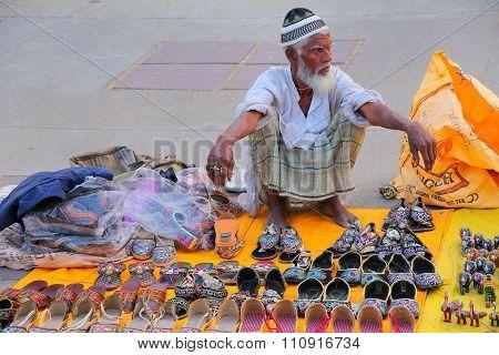 Jaipur, India - November 13: Unidentified Man Sells Slippers By Man Sagar Lake On November 13, 2014