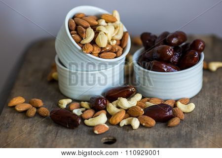 An Assortment Of Healthy Nuts In A Bowl : Almond, Cashew, Dates And Hazelnut, Making A Healthy Snack