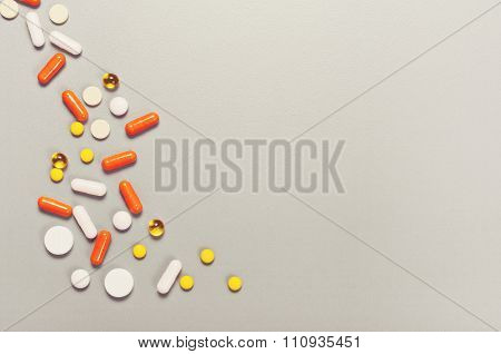 Scattered Pills On A Gray Background