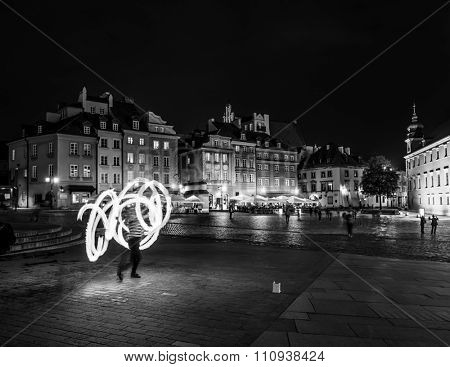 fire show in evening on a Warsaw square, Poland