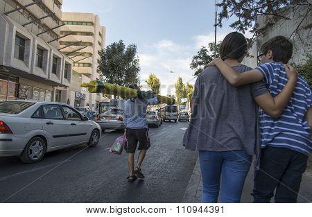 Jerusalem, Israel- September 27, 2015: Israeli man carry sukkah people walking in street , Jerusalem