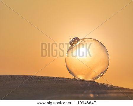 Christmas-tree Transparent Decoration Glass Ball At Sunset Sandy Beach