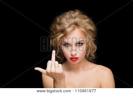 Stylish fashion blonde girl showing middle finger. isolated on a black background