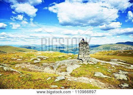 Rocks cairn at mountains