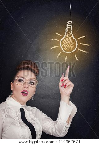 Idea Concept. Woman Showing On Lamp