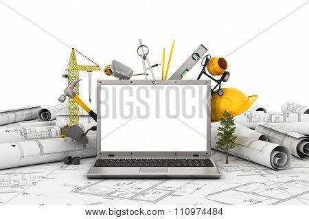 The Laptop With Empty Screen And Object For Construction. Blueprints And Safety Helmet Over A Table
