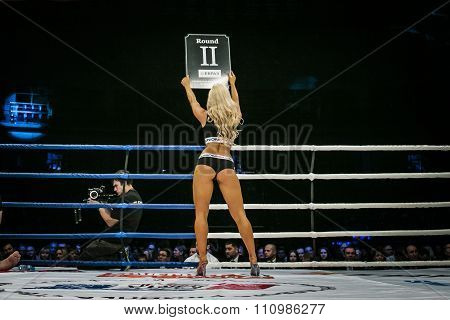 beautiful sexy girl in ring, his back is facing table shows number of round
