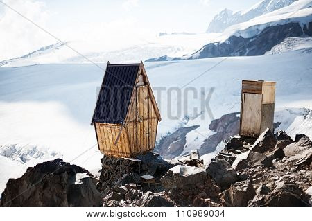 Old Wooden Toilets On Permafrost Glaciers In Mountains