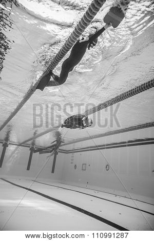 Dynamic No Fins Freediver During Performance From Underwater