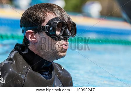 Freediver Finishing A Static Apnea Performance After Few Minutes Of Breath Hold.