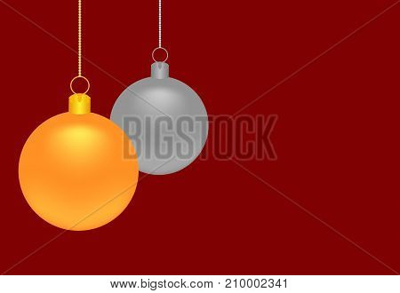Gold and silver Christmas balls on a dark red background with copy space for text.