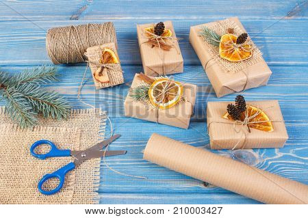 Accessories, Decoration And Wrapped Gifts For Christmas Or Other Celebration On Old Boards